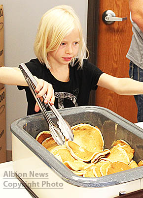 Kassidy Beister, daughter of Richard nad Andrea Beister, was helping out by serving pancakes at the Albion Fire & Rescue fund-raiser last Sunday.