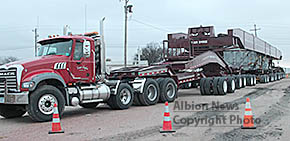 Tractor-trailer rig that will haul large transformers to Neligh.