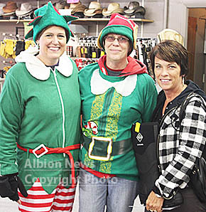 Elves are making the rounds in downtown Albion, handing out Chamber bucks and local business coupons.