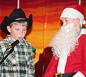 The Candy Cane Kid in conference with Santa.