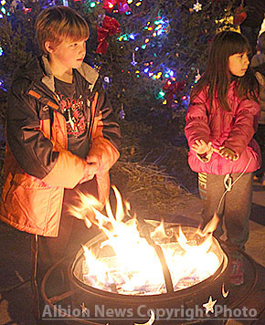 Children wait by the fire for a Polar Express bus ride last Thursday night.