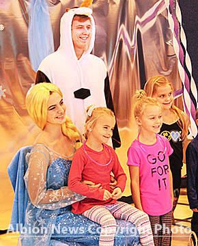 Kyley Sorrell as Elsa and Nocholas Knuth as Olaf entertain at the Boone County Fitness Center.