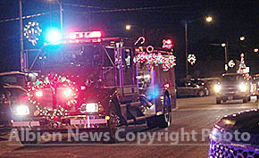 An Albion fire truck leads the Light Parade.