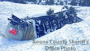 A Nebraska Department of Roads plow truck went off the road and rolled into a ditch during white out conditions on Highway 14 south of Albion.