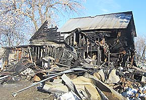 Remains of the Dennis Scholl home after the Feb. 14 fire.