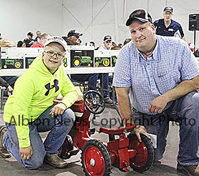 Dave Figgner III and Dave Figgner Jr. with some of the toys sold at auction last Sunday.