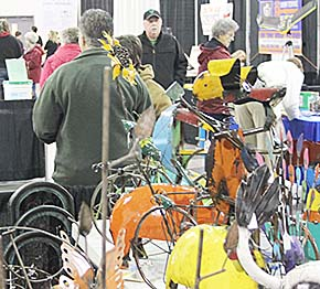 Customers look over the merchandise during the Home, Farm and Garden Show last Saturday.