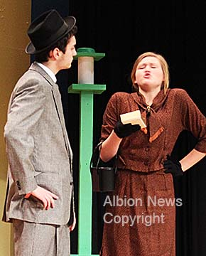 Two primary cast members, Thomas Hosford and Dana Grape, rehearse for the upcoming spring musical.