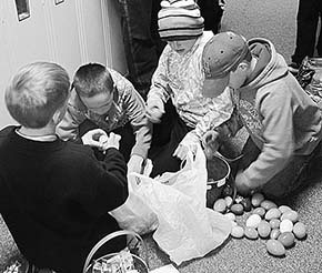 This group was having a good time sorting eggs at the Petersburg Easter Egg Hunt.