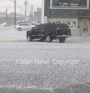 Church Street in downtown Albion was covered with hail after the Tuesday storm.