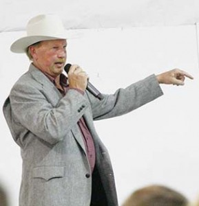 Auctioneer John Kennedy sells another item at the Cattlemen's Banquet.