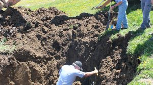 LEAK REPAIR – City Water Commissioner Ron Morearty, Street Commissioner Jim Bader and City Councilman Jon Porter were working on the scene to repair the water leak Monday afternoon.