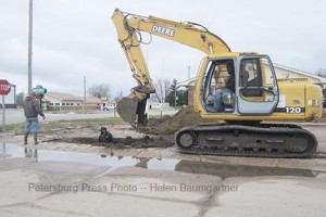 Crew from Rutjens Construction repairs the water main serving west Petersburg last Friday.