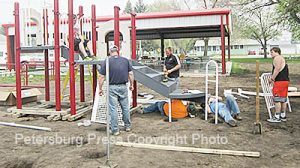 Erection of playground equipment at the downtown park.