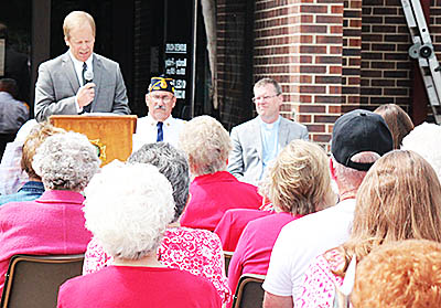 Tom Briese addresses the crowd at Memorial Day ceremonies in Albion.