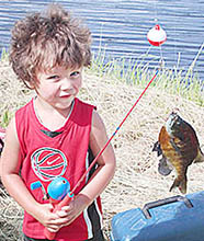Trytten Friese, age 3, was happy after catching his fifth fish of the day.