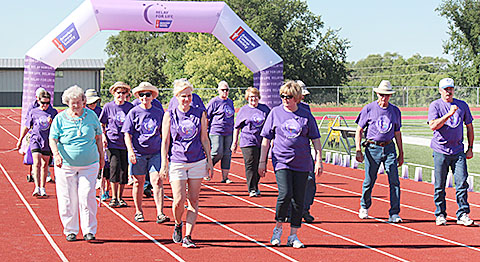 Cancer survivors begin their opening lap of the Boone County Relay for Life.