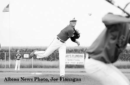 Albion pitcher Kyle Kramer delivers during action in the Class C Area 5 Tournament at Osceola.