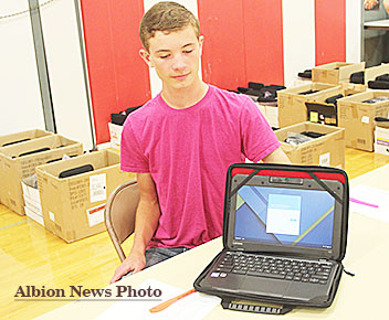 NEW LAPTOPS -- Boone Central student Walker Stuhr displays one of the 406 Chromebooks computers that were passed out to students during registration last week.