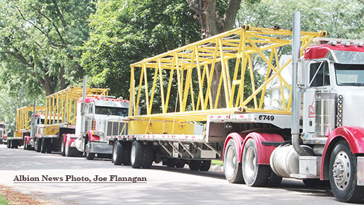 Crane extensions arrived aboard three semi tractor-trailers.