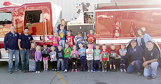Albion Fire & Rescue personnel with local preschoolers.