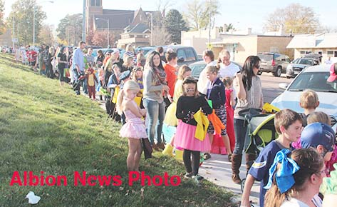 Children line up for the Halloween Parade along the north side of the courthouse square.