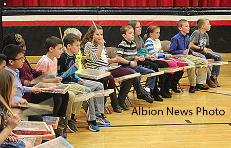 Students play their handmade drums with Michael Fitzsimmons during the Nov. 17 program.