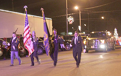 Veterans Color Guard leads the Albion Christmas Light Parade.