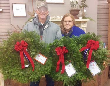 Ken and Donna Iwan of Albion placed three wreaths in honor of family members.