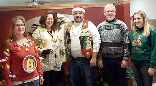SENTINEL BUILDING SYSTEMS crew winning first place in the Ugly Sweater Contest included (l.-r.) Andrea Beister, Sandra McBride, Ron Harris, Kevin Gottier and Jamie Couch.