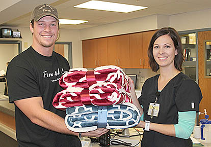 BLANKET DRIVE -- Farm 4 A Cure founder Donny Baker and Tara Leetch with blankets now available at Boone County Health Center for those in need.