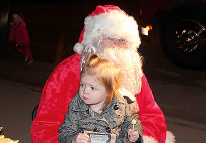 MEETING SANTA -- Two-year-old Vivian Buck, daughter of Allen and Rachael Buck of Albion, was one of children meeting Santa Clause at the Albion Vet's Club on Dec. 1. Santa arrived aboard an Albion Fire & Rescue truck.