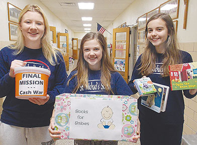 Making preparations for special Catholic Schools Week events at St. Michael's last week were, l.-4., Rose Murcek, Claire Nelson and Julia Nore.