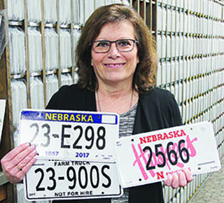 Boone County Treasurer Laurie Krohn with the new license plates to be issued in 2017.