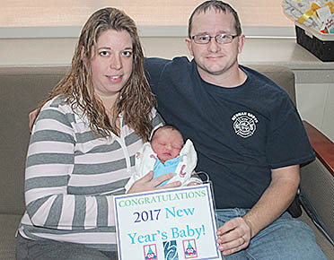 NEW YEAR'S BABY -- Dashiel Lee Morris with his parents, Andrea and Dan Morris of Newman Grove.