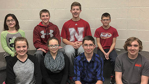 TOP EIGHT -- Earning the top eight places in the Boone County Spelling Bee were (front, l.-r.)  1st place Rachel Malander;  tied for second place, Grace Tibor (St. Edward), Bradley Schindel (Boone Central), Isaak Welch (St. Edward); and back, l.-r.,Sadie Baldwin (Riverside), Ryan Kramer (St. Michael's), Gage Groeteke (St. Michael's), and Nathan Devine (Boone Central).