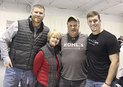 "University of Nebraska offensive lineman Sam Hahn of DeWitt, along with (l.-r.) Jill and Gerald Foltz of Greeley County, parents of late NU punter Sam Foltz, were special guests of honor at a ""Feed the World Tour"" fundraiser. With them (right) is Farm 4 A Cure organizer Donny Baker."