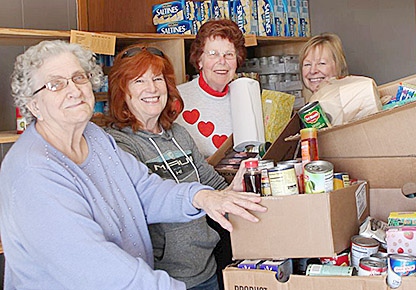 Zion Lutheran Church volunteers packing grocery boxes for a client on a recent Thursday were (l. - r.) Bev Rieck, Connie Bentjen, Elsie Wheeler and Mary Levander.