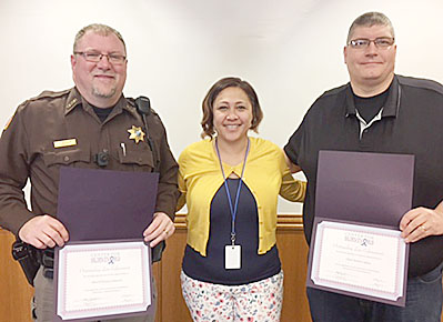 Angela Kelani of the Center for Survivors with Sheriff Denny Johnson, l., and Albion Police Chief Brent Lipker, r.