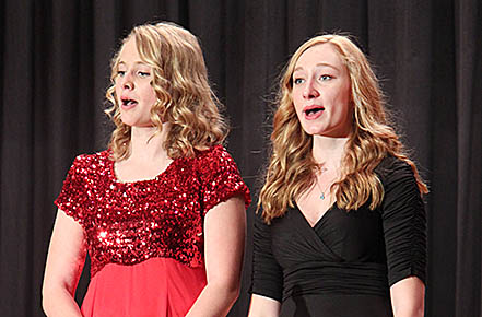 "SINGING SISTERS -- Emily, l., and Olivia Groeteke sing ""Sisters"" from the musical ""White Christmas."""