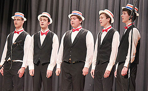 "Men's chorus performs in barbershop style from the musical ""Music Man."""