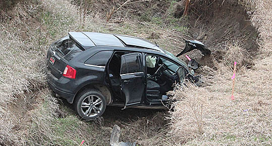 SUV at the bottom of a ravine after Tuesday's accident.