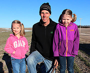 John Krohn with daughters Annie, l., and Kasey, r.,