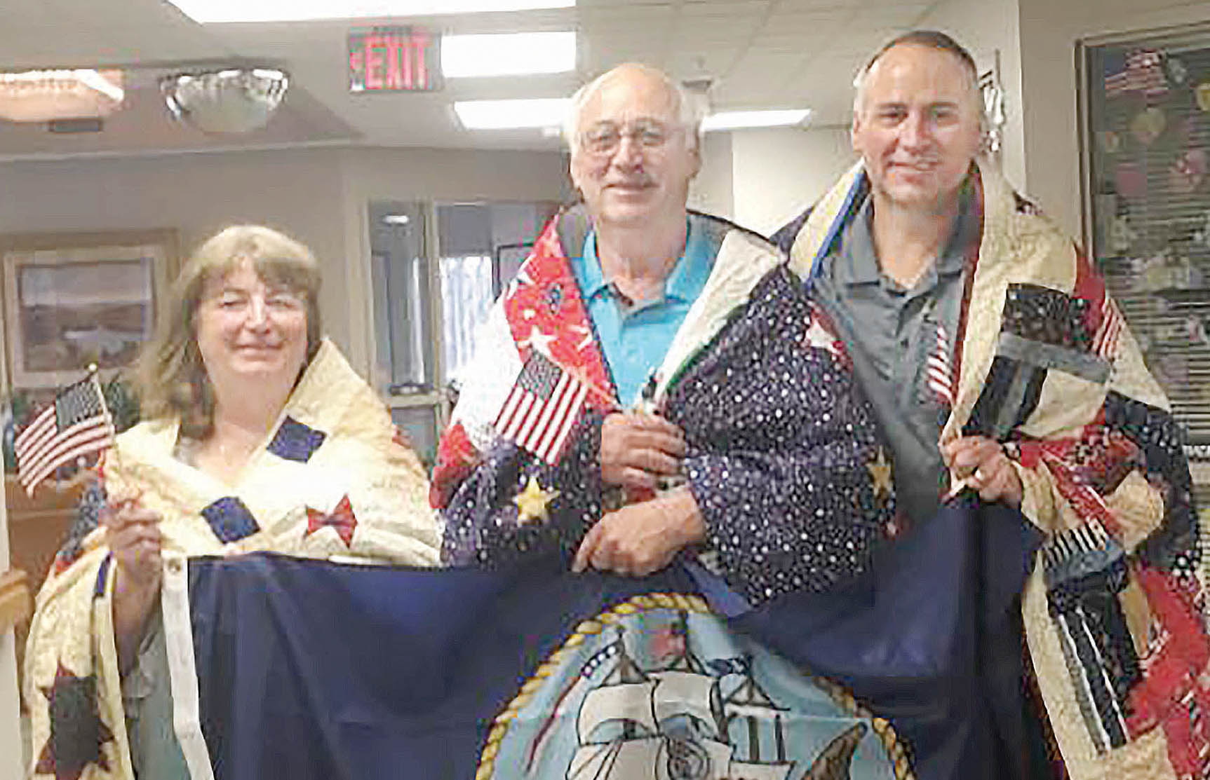 The Leifeld siblings receiving 'Quilts of Valor' at Norfolk on April 15, were (l.-r.) Deanna R. Leifeld Bogart, Kerry Leifeld and Kevin J. Leifeld.