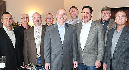 Officers and directors of the Central Plains Corn Growers greeted Gov. Pete Ricketts at their annual meeting last Tuesday night, March 28. Shown with Gov. Ricketts (center) are (l.-r.) Dallas Choat, Ken Shriver, Dave Warner, Randy Pelster, Bill Dodds, Clark Bryan, Dave Marrell and Don Gasper.