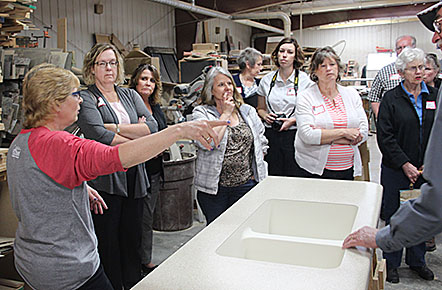 Barb Krohn leads a tour at Country Laminates in Albion.