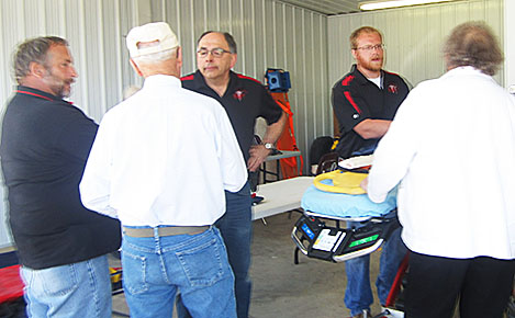 Petersburg Rescue Squad members (l.-r) Dale Salber, Jim Leifeld and new member Jared Seier visit with Bert Ketteler and Charles and Darlene Stuhr during the open house last Sunday.