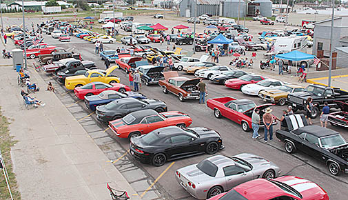 Overhead photo of the Smoke n Chrome Car Show taken from the roof of Albion ThriftyWay.