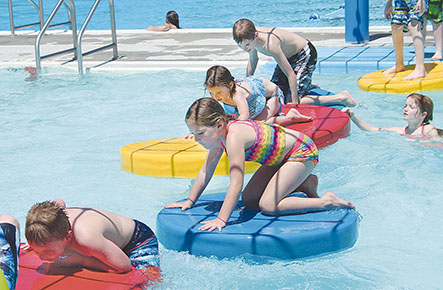 The lily pads (above) were a popular attraction on opening day at the Albion Family Aquatic Center.