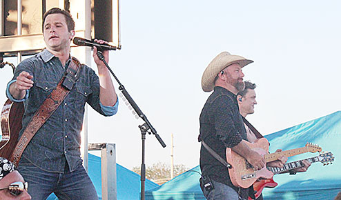Easton Corbin, l., performs with his band Saturday night at the Boone County Fair.